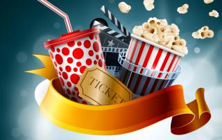 Popcorn mit Getränk und Filmklappe